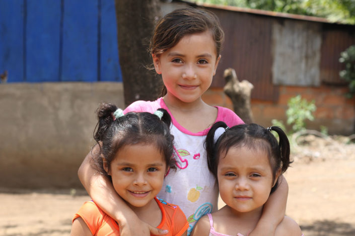 Three young girls posting for a picture in the El Conejo community